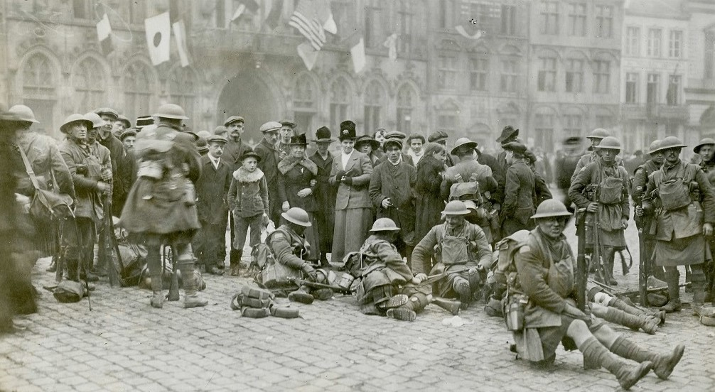 Canadian soldiers at rest in the Grand Place, Mons on 11 November 1918